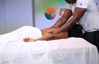 Ransford massaging a client